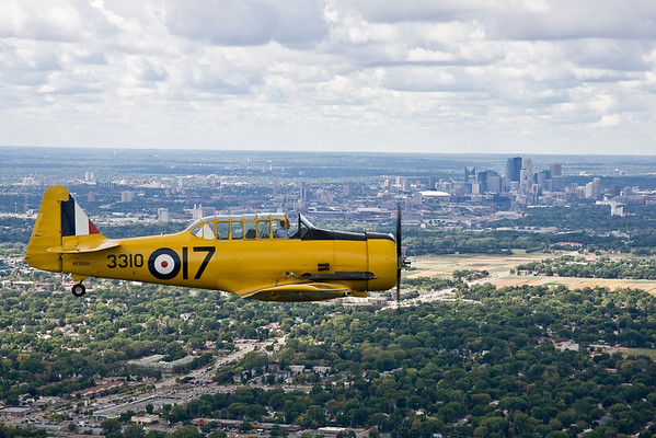 The beautiful yellow Harvard with Minneapolis in the background.