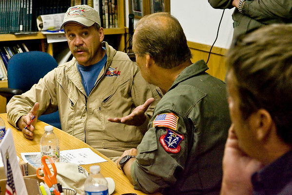 P-51 pilot, Allen Miller, asks a question during the briefing.
