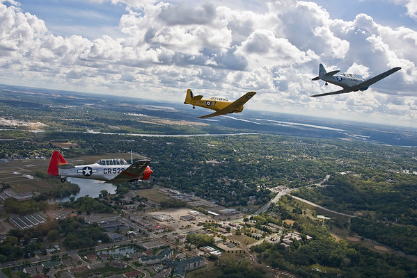 The three T-6 aircraft airborne west of Fleming Field; Mississippi River is in the background.