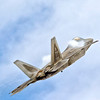 F-22 Raptor flight pulling vapor at Tuscaloosa Airshow