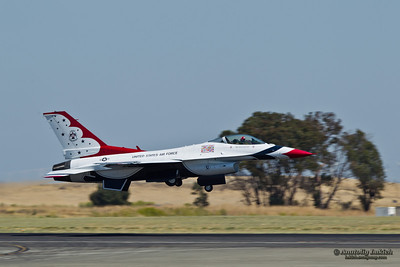 TRAVIS AIR FORCE BASE, CA - JULY 30: US Air Force Thunderbirds Demonstration Squadron, flying on Lockheed Martin F-16 Fighting Falcon showing precision of flying and the highest level of pilot skills during  Airshow  on July 30, 2011 at  Travis Air Force Base, CA.