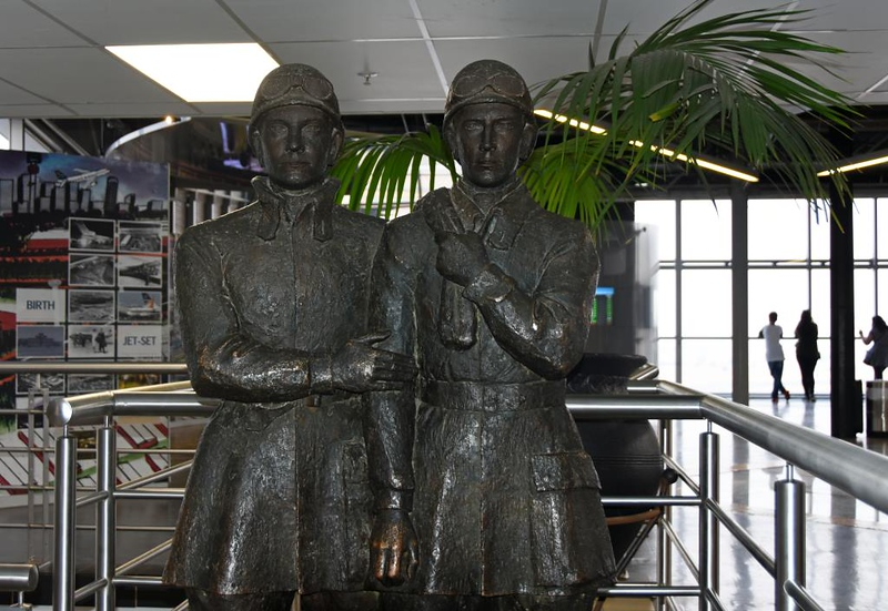 Statue of Lt Col Pierre van Ryneveld & Squadron Leader Quintin Brand, Johannesburg O R Tambo International Airport, 23 September 2018 1. The two men made the first flight from London to Cape Town, in 1920.  They and two mechanics flew two Vickers Vimys, both of which were written off, and finshed in a de Havilland DH9.  Their 6000 mile flight took 45 days, compared with 12 hours non-stop now.  (The sea voyage from Southampton took two weeks.)  The flight won a £5000 prize and both officers were knighted.