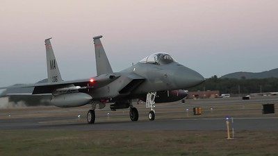 four F-15s taxiing and taking off at dusk during an Operational Readiness Exercise