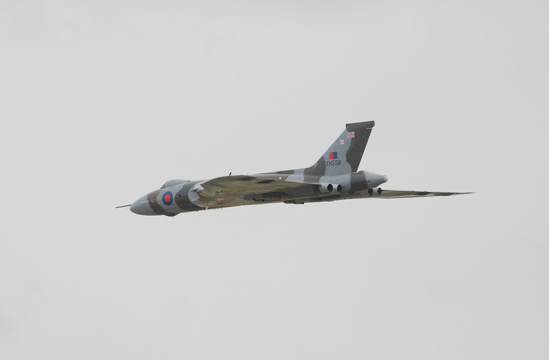 XH558 flies past the assembled crowds at Manchester Airport's Runway viewing park on 10th October 2015.  I nearly missed this hastily grabbed shot due to my kids being more interested in the play trailer that is now on site!!