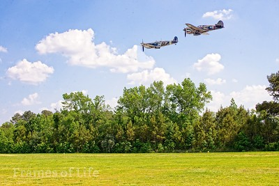 Curtiss P 40 and British Spitfire in Traffic Pattern