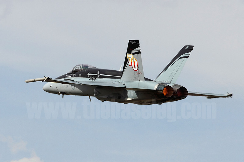 Royal Australian Air Force F/A-18A Hornet A21-38 in the stunning 75 Sqn 70th Anniversary scheme climbs away in afterburner after executing a missed approach.