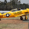 Steve Death's North American T-6G Texan VH-YVI taxis for takeoff prior to the Southern Knights aerobatics team's display.