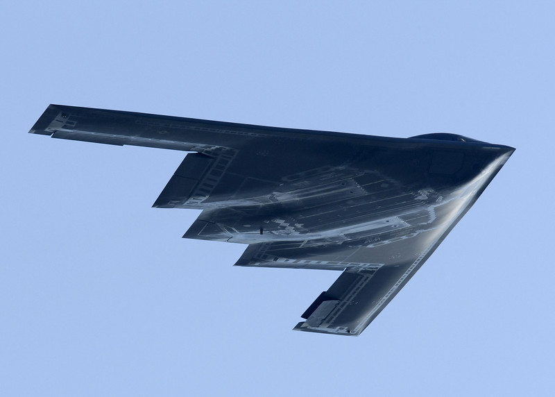 """The Northrop Grumman B-2 Spirit (also known as the Stealth Bomber) is a multirole heavy bomber with """"low observable"""" stealth technology capable of penetrating dense anti-aircraft defenses to deploy both conventional and nuclear weapons. Because of its astronomical capital and operations costs, the project was controversial in Congress and among Pentagon brass during its development and placement into service. In time, Congress scaled back initial plans to purchase 132 of the bombers. By the early 1990s the United States elected to purchase just 21 of the bombers at US$737 million per aircraft. Total program cost averaged US$2.1 billion per aircraft in 1997 dollars.[3]<br /> <br /> The B-2 is operated exclusively by the United States Air Force with none in the Air Force Reserves. Though originally designed in the 1980s for Cold War operations scenarios, B-2s have been used in combat to drop bombs on Kosovo in the late 1990s, and see continued use during the ongoing Wars in Iraq and Afghanistan.<br /> <br /> Featuring formidable design specifications, a two officer crew aboard the bomber can drop up to eighty 500 lb (230 kg) class JDAM """"smart"""" bombs, or sixteen 2,400 lb (1,100 kg) B83 nuclear bombs in a single pass through extremely dense anti-aircraft defenses. The bomber has been a prominent public spectacle at air shows since the 1990s. It has been the subject of espionage and counter-espionage activity."""
