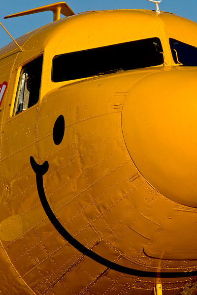 """""""Duggy - The Smile In The Sky"""" DC-3 captured a smile at AirVenture 2008 in OshKosh, Wisconsin<br /> <br /> The Douglas DC-3 is an American fixed-wing, propeller-driven aircraft whose speed and range revolutionized air transport in the 1930s and 1940s. Because of its lasting impact on the airline industry and World War II, it is generally regarded as one of the most significant transport aircraft ever made."""