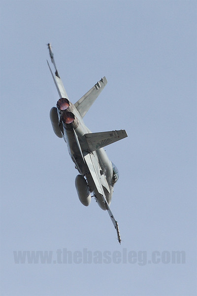 A 3 Sqn F/A-18A banks hard in afterburner