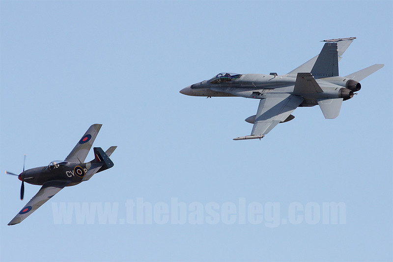 A mixed formation of a CAC Mustang and F/A-18A Hornet