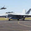 RAAF F/A-18F Super Hornet A44-207 taxis out for its display while a RAN Seahawk performs