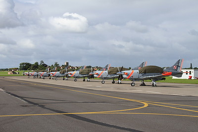 7 PZL-130 Orlik trainers of the Polish Air Force Aerobatic team 'Team Orlik' on the pad ready for later display - 02/07/16.
