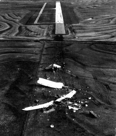 A photo from the official crash report, looking north across the crash site.  Clinton MAP's runway 17/35 is at the top.