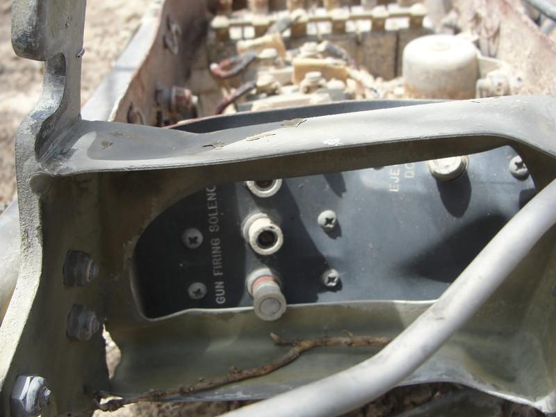 Circuit breakers for the gun firing solenoids and the cartridge casing ejection door.