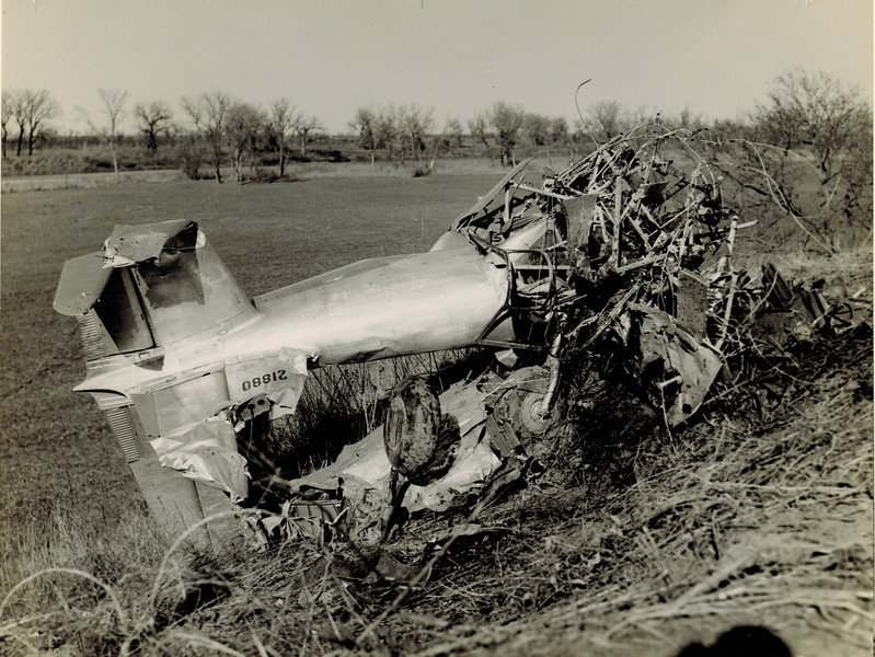 Vultee BT-15 42-1880 22 December 1942<br /> <br /> This airplane was being ferried from Enid AAF to Winfield, Kansas when the pilot flew low over the Arkansas River, struck power lines and crashed. The pilot did not survive.