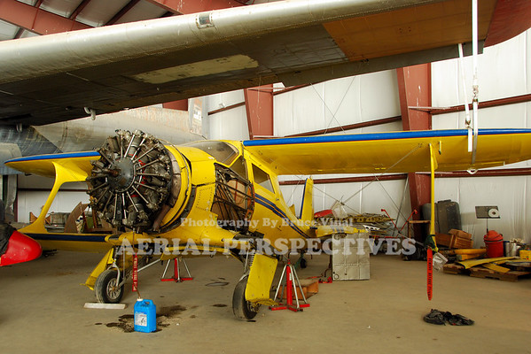 1945 Beech Staggerwing D17S  Getting a little help from a C-119