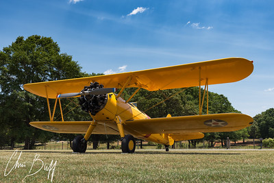 Yellow Stearman Under a Blue Sky