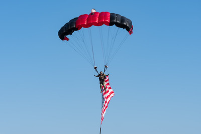 Skydiver delivers the colors to show center at Robins AFB. Part of the U.S. Army Special Operations Command Black Daggers team.