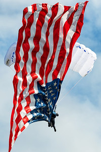 Skydiver Delivers the US Flag to Show Center