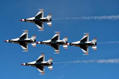 Thunderbirds in tight formation over Robins AFB