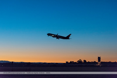 F20151002a063056_2278-plane taking off-control tower-in the night-settings