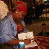 Leymah signs books after her talk.