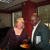The Revs. Linda Johnson Seyenkulo and Jensen Seyenkulo enjoy refreshments after Leymah's talk.