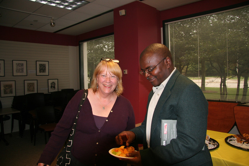 The Revs. Linda Johnson Seyenkulo and Jensen Seyenkulo enjoy refreshments after Leymah's talk.