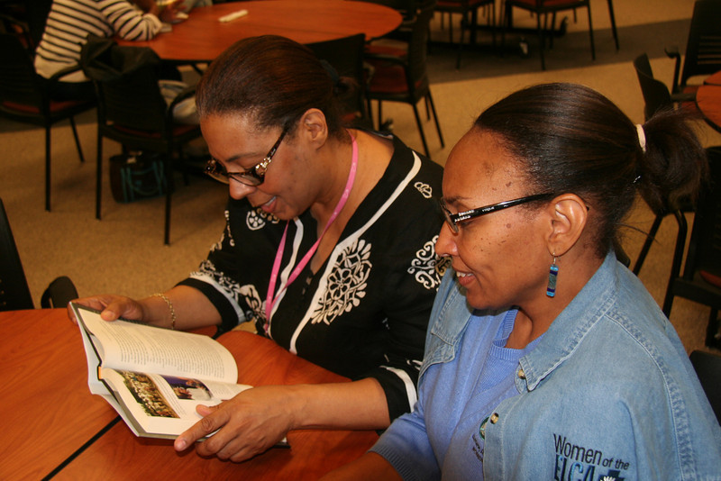 Vanessa Davis (left) and Deb Powell check out a newly signed book.
