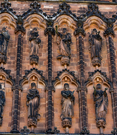 ornate statues f saints iembeded into the west wall exterior.