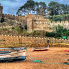 The Beach and Castle Walls of Tossa de Mar in the Region of Catalonia Spain