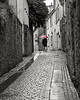 Irish Red Umbrella, Kilkenny, Ireland<br /> colored B&W photo<br /> in New Hope Art League 2011 Juried Show