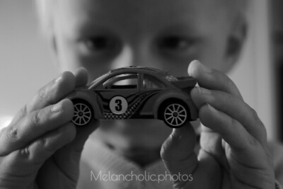 boy fascinated from a car
