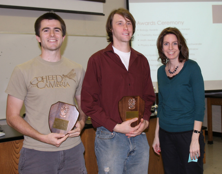 Philip Cox and Trever Meek are recognized by Dr. Carrie Bentley for their award-winning presentations at the area Tri-Beta Chapter meeting.