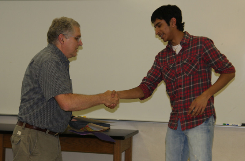 Nitesh Patel is congratulated for the Outstanding Freshman Biology Award.