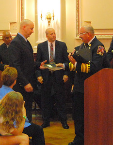 FF Andrew Kutz receives an award, Jason Batz