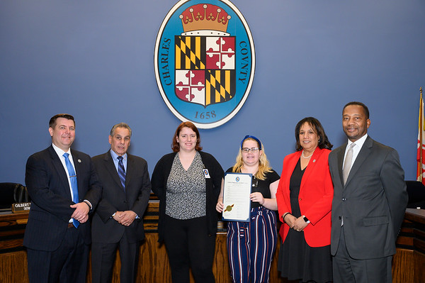 Maranda Carlson and Kim Cook accept a proclamation on the behalf of Maryland MENTORE.