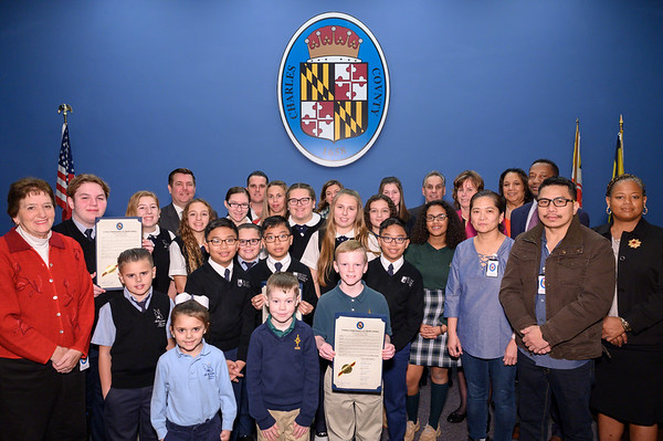 St. Peter's School, St. Mary's Bryantown Catholic School, Archbishop Neal School and Archdiocese of Washington accept an award for Catholic School Week.