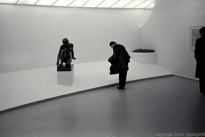 A visitor to the Guggenheim museum, New York, USA
