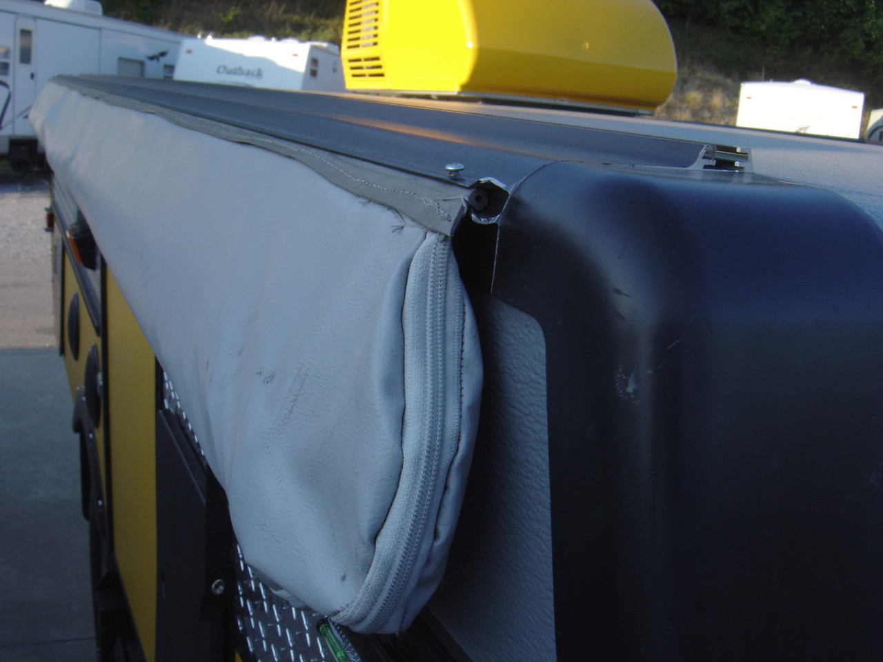"""The awning is secured to the """"C"""" channel by two screws at each end. The screws must go through the rubber as seen above."""