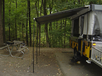 Awning secured with three bungee cords.  Note you can use cords or ratcheting tie downs.