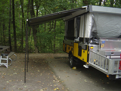 "Raise the PUP top all the way up.  See ""Securing the awning"" gallery for ways to secure the awning."