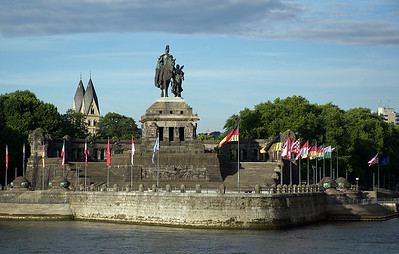 The monument at the junction of the Rhine and Mossed rivers at Koblenz.  Most of the flags are those of the various German states, but there is also a lone American flag which is a memorial to the victims of 9/11.