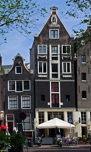 The Van Speyk is a good place to eat.  But you will notice the buildings are not parallel.  Lots of odd angles in Amsterdam.  I guess that's what happens when you build on mud.