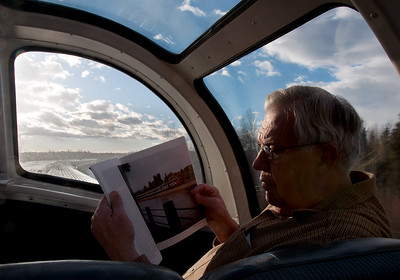 Bill peruses an article about the CN Intercontinental while riding the route on what is now the VIA Canadian.