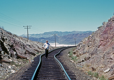 "One of the perks of working in BTR was ""trip passes"" that allowed us to ride trains on weekends.  Here Bryan Whipple inspects a sun kink on the WP while we were riding a freight train from Klamath Falls to Carlin.  September 1968."
