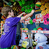 Jonathan Roy, 10, of Shirley plays some carnival games after the Ayer 4th of July parade at Pinore Park. SUN/Caley McGuane