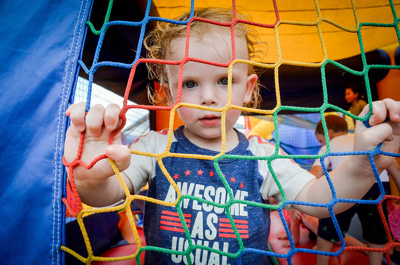 Clayton Palmer, 2, of Ayer has fun in the bouncey house after the Ayer 4th of July Parade at Pinore Park. SUN/Caley McGuane