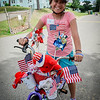 Julia Delgado, 11, of Ayer decorated her bike for the Ayer 4th of July parade. SUN/Caley McGuane